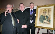 Knights of Columbus Council 1394 makes a donation of a picture of St Patrick to St Patrick's Parish